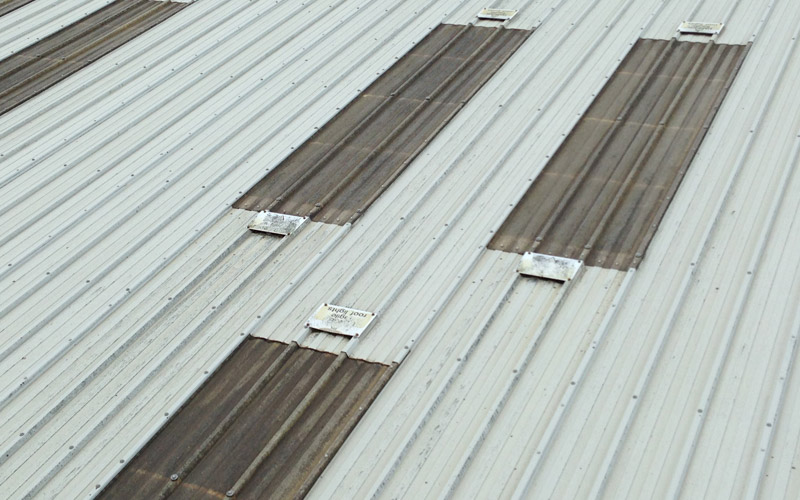 Old GRP rooflights in Birmingham before being replaced