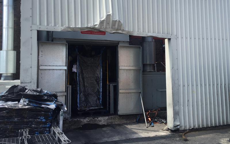 Forklift impact damage to industrial unit door