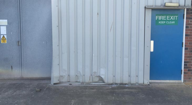 Damaged low level wall cladding.