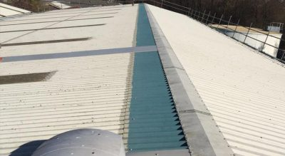 Cut edge corrosion treated with Giromax plus new fixing joints applied to every crown corrugation.
