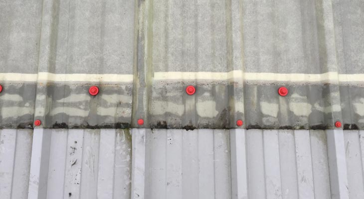 Close up photo of new poppy red fixings around rooflight edges
