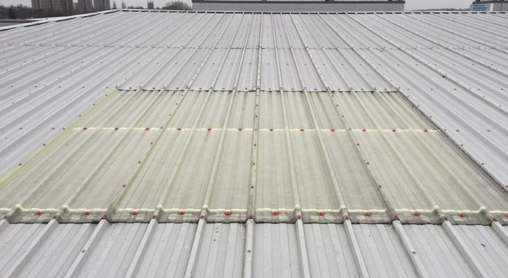 Industrial rooflight with poppy red fixings