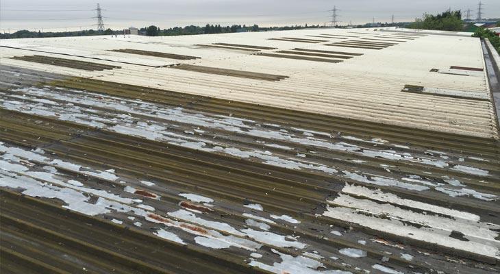 View of old industrial roof in need of repair