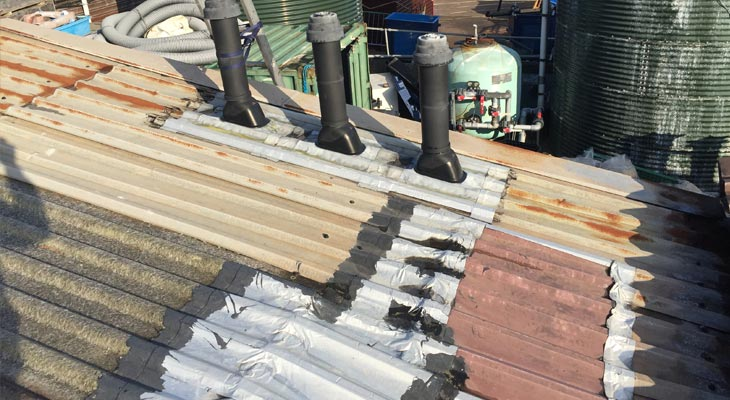 Roof sheet delamination and temp repairs to roof penetrations and midlap joints