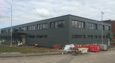 Installation of anthracite grey Kingspan wall cladding in Wrexham