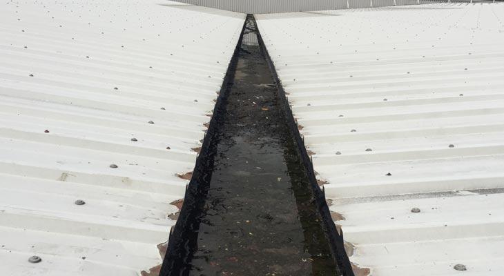 Industrial roofing valley gutter in need of repair