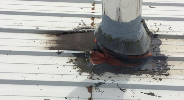 Roof penetration with water ingress from historic temporary repair
