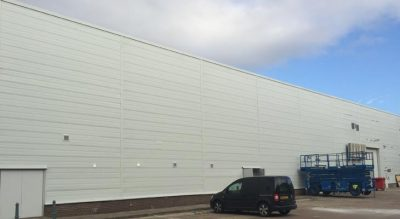 Completed wall cladding overspray with Giromax in Dudley