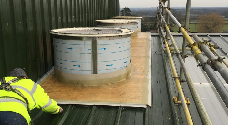 Coverclad GRP roofing specialists boarding out around cylinder flu stacks