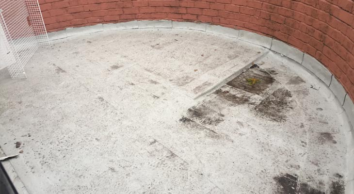 Circular flat roof after being cleaned