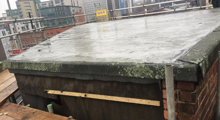 Old dilapidated plant room GRP felt roof