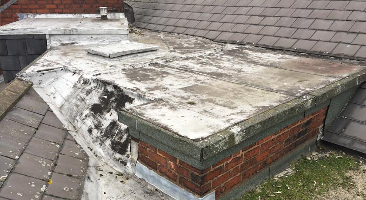 Old felt flat roof coated with failing liquid applied membrane