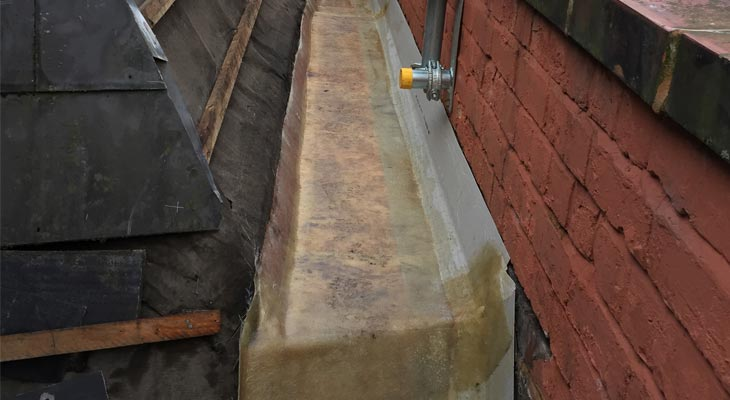 OSB boards and fleece installed to form gutter base and upstands