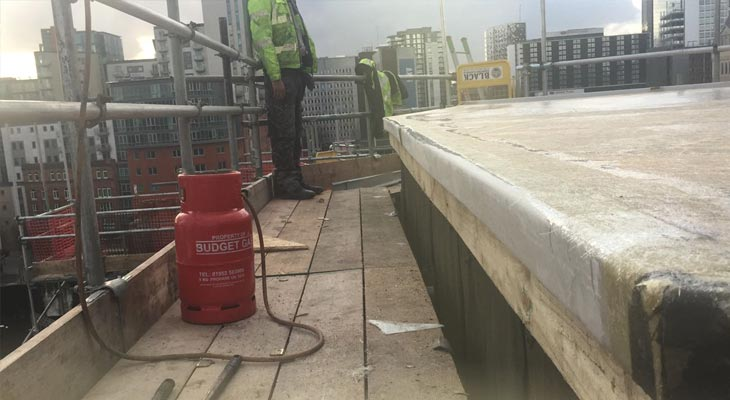Resin being applied to plant room flat roof