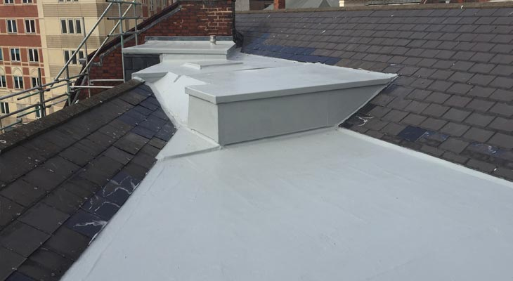 Three connected flat roofs with new GRP roofing