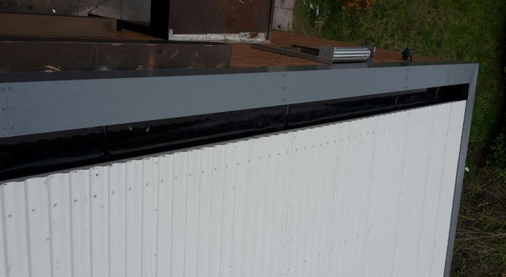 Roofing overclad with new barge flashings and Plygene Gutter Liner