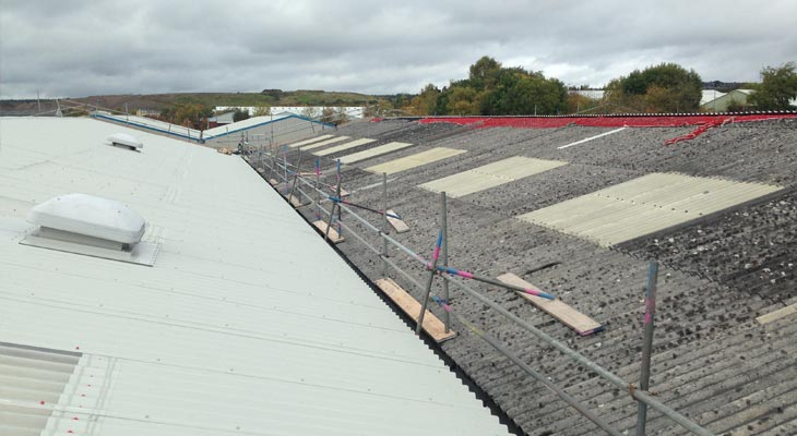 First slope completed of the asbestos roofing overclad in Dudley
