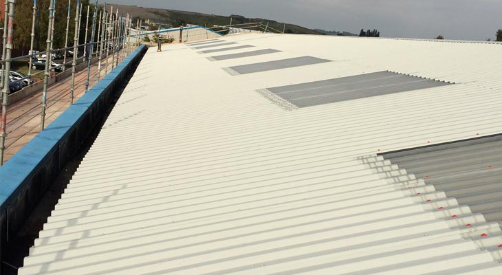 Over-cladded roof slope fully stitched down