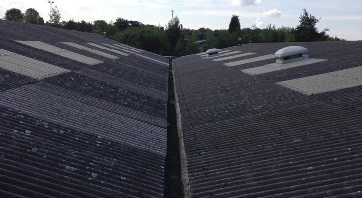 View along valley gutters of asbestos cement roof