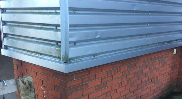 Newly installed base sill flashings in silver PVF2 finish