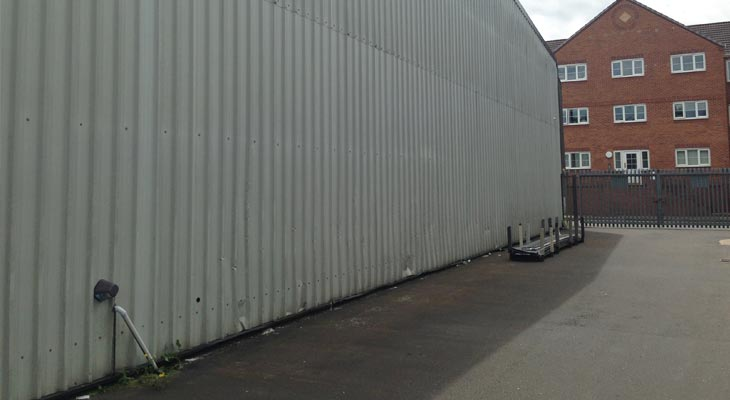 25 metre long rear elevation with low-level impact damage