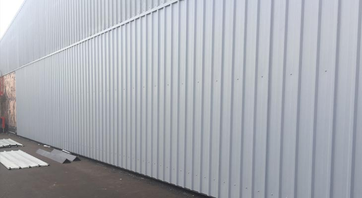 Newly installed single skin plastisol coated metal profile sheets