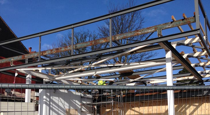 Front view of the new showroom extension steel columns and framework