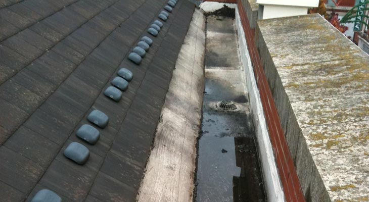 Old felt gutter in Leicester at retail store