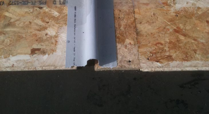 Close-up of expansion trim fixed down onto marine ply boards