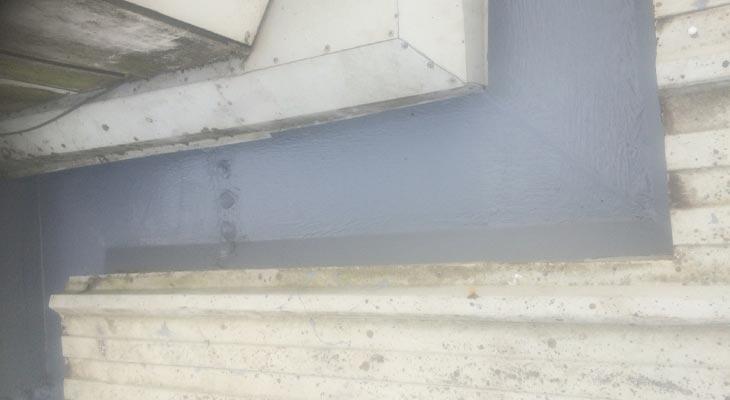 Giromax HPG topcoat applied around industrial gutter bends