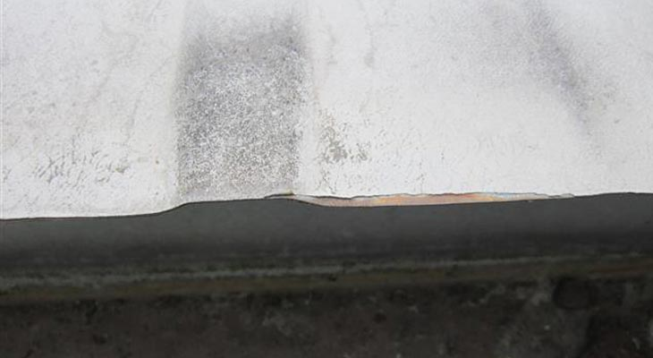 Close-up of cut edge corrosion to the roof eaves