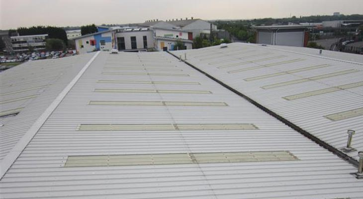 Wider view of four roof slopes with hundreds of linear meters of cut edge corrosion