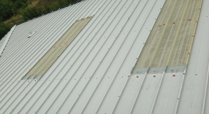 Rooflights with top edges treated with Giromax plus old fixings replaced with new poppy red fixings
