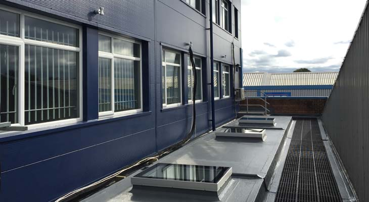 GRP flat roof with skylights installed