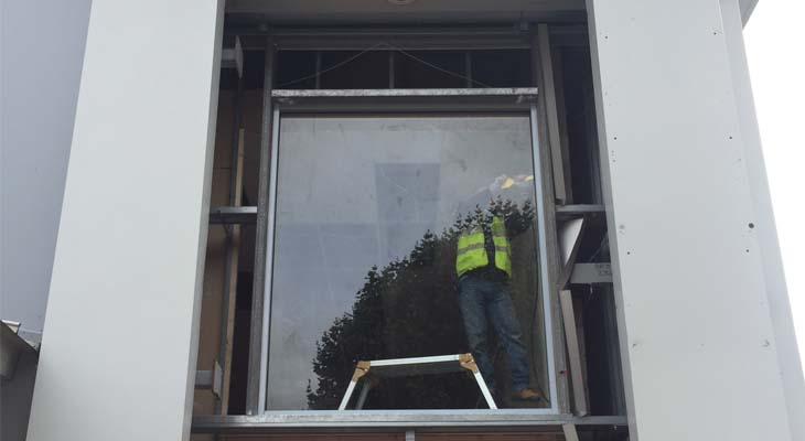 Cladding removed and glazing being installed