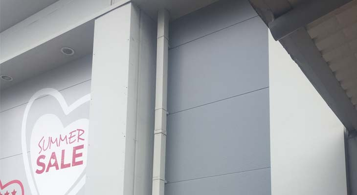 Existing wall cladding and downpipe