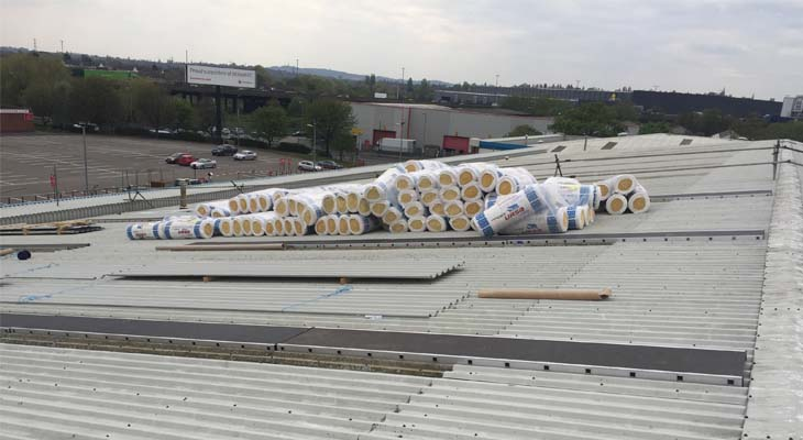 Rolls of insulation on roof