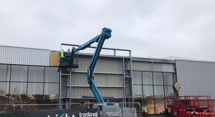 Cladding experts working from articulated boom