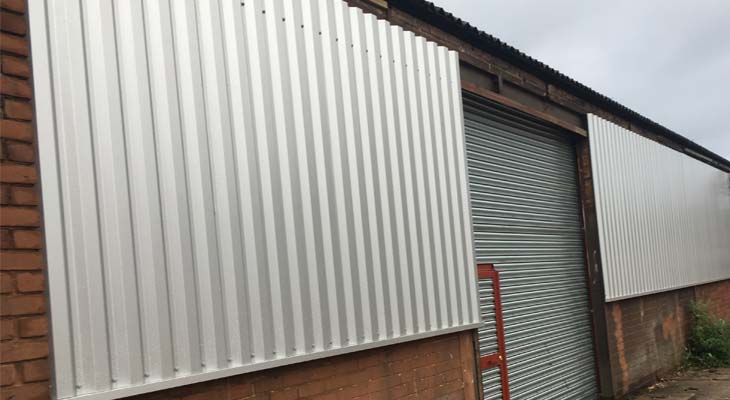 Cladding sheets and base sills fitted