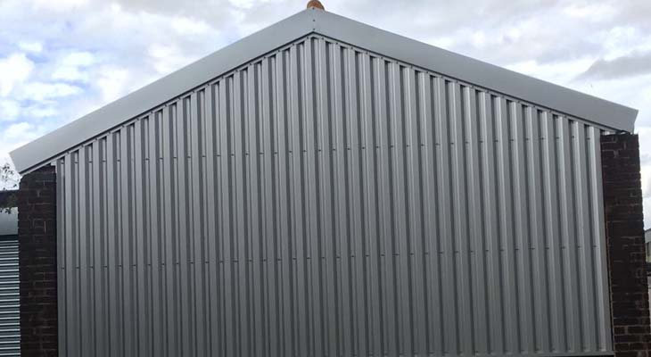 Wall cladding and barge flashing installed