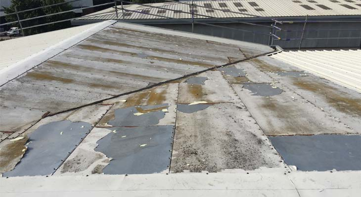 Flat plate overclad system needing repairs