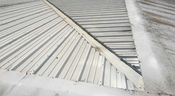 Hip valley gutter with cut edge corrosion