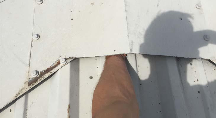 Inserting hand under roof ridge
