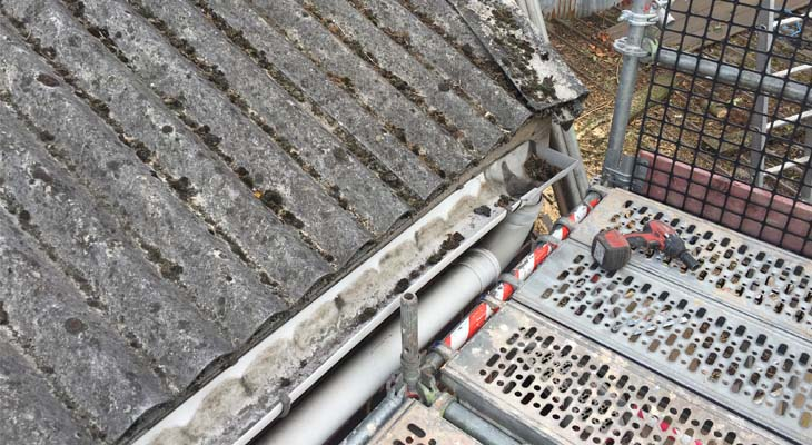 Before close-up of existing plastic gutter to be removed