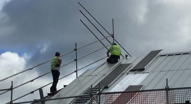 Kingspan installers fitting RW1000 composite roofing panels