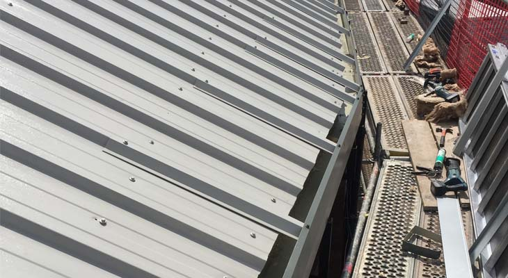 Roof level view of metal trimline gutter installed