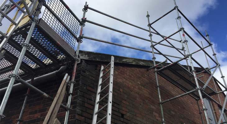 Triple handrail scaffold edge protection with access tower and walk platform