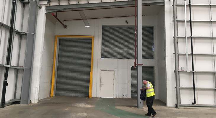 Operative walking out through the loading bay extension