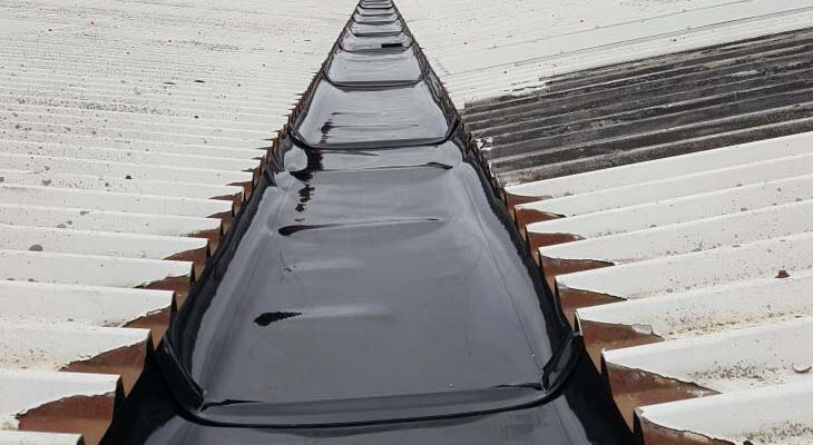 Close-up of Plygene Gutter Liner installed to valley gutter