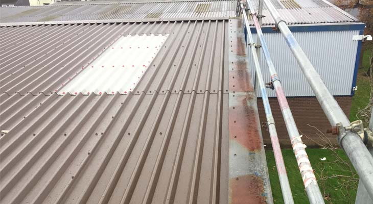 Existing barge flashings reused with newly installed roof sheets